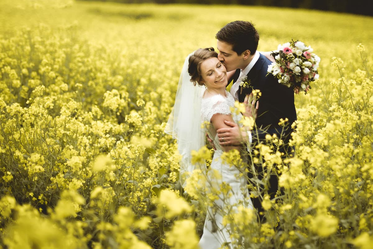 wedding couple in rapeseed field