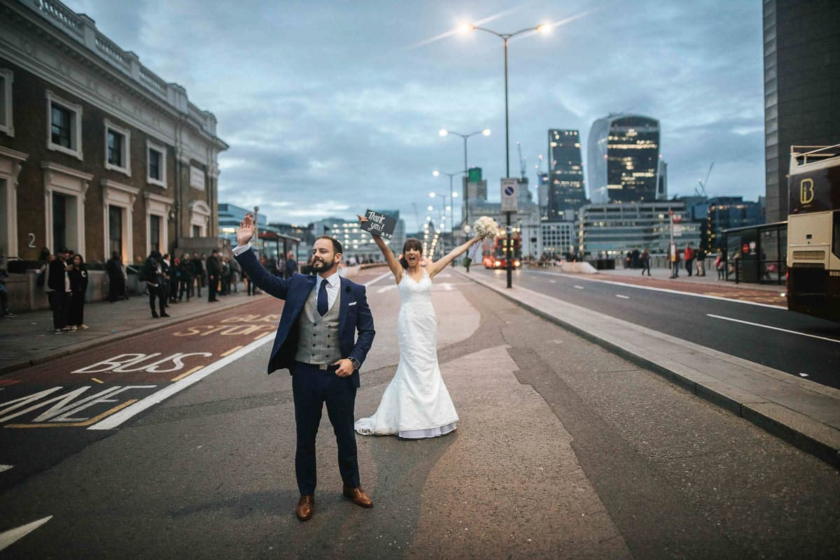 happy bride and groom at london bridge