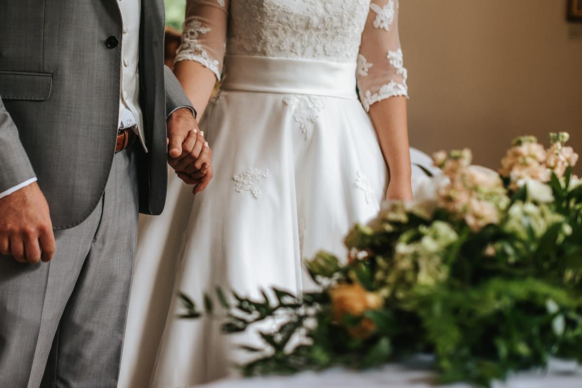 pembroke lodge wedding holding hands