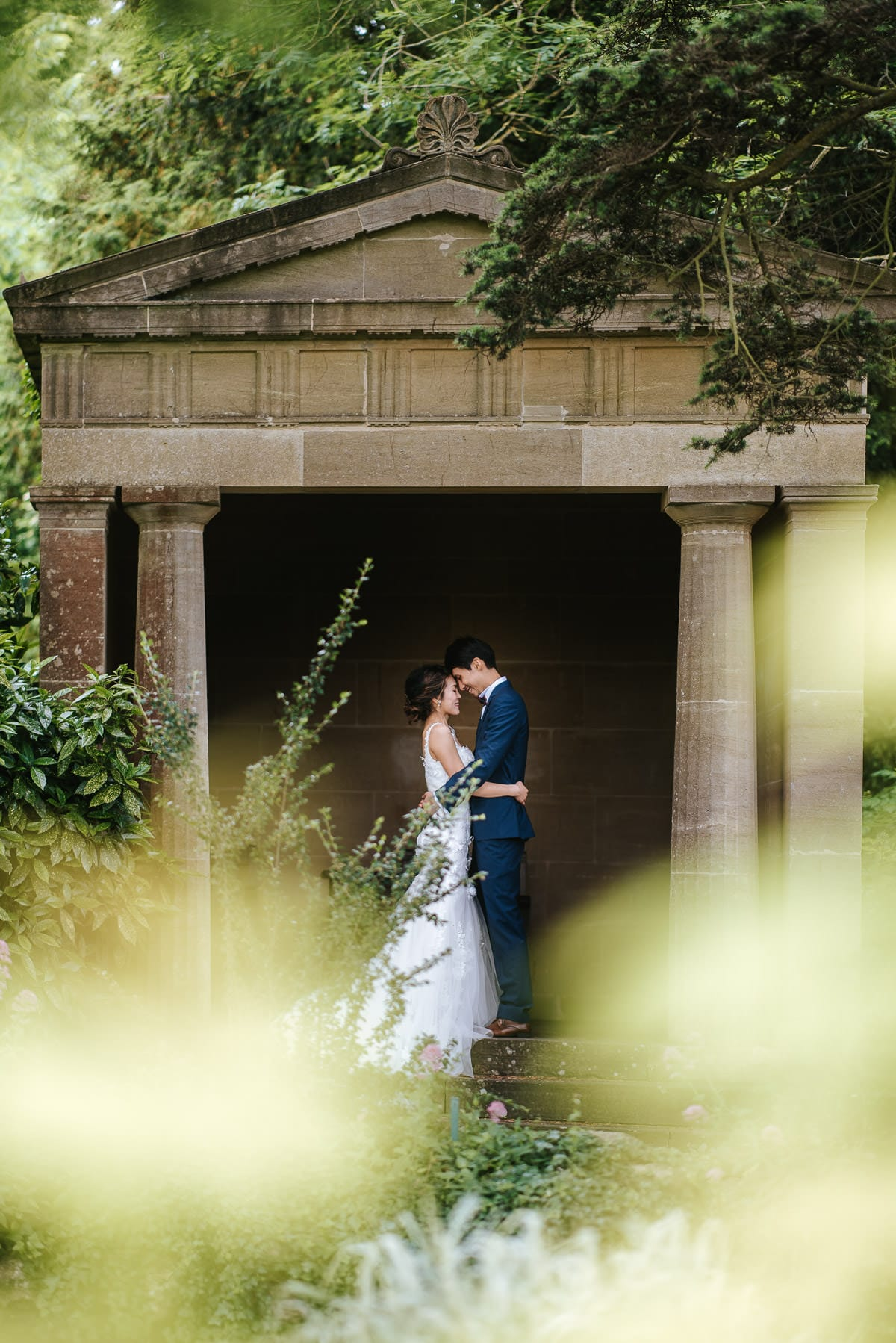 somerset wedding photography couple embracing in the gardens