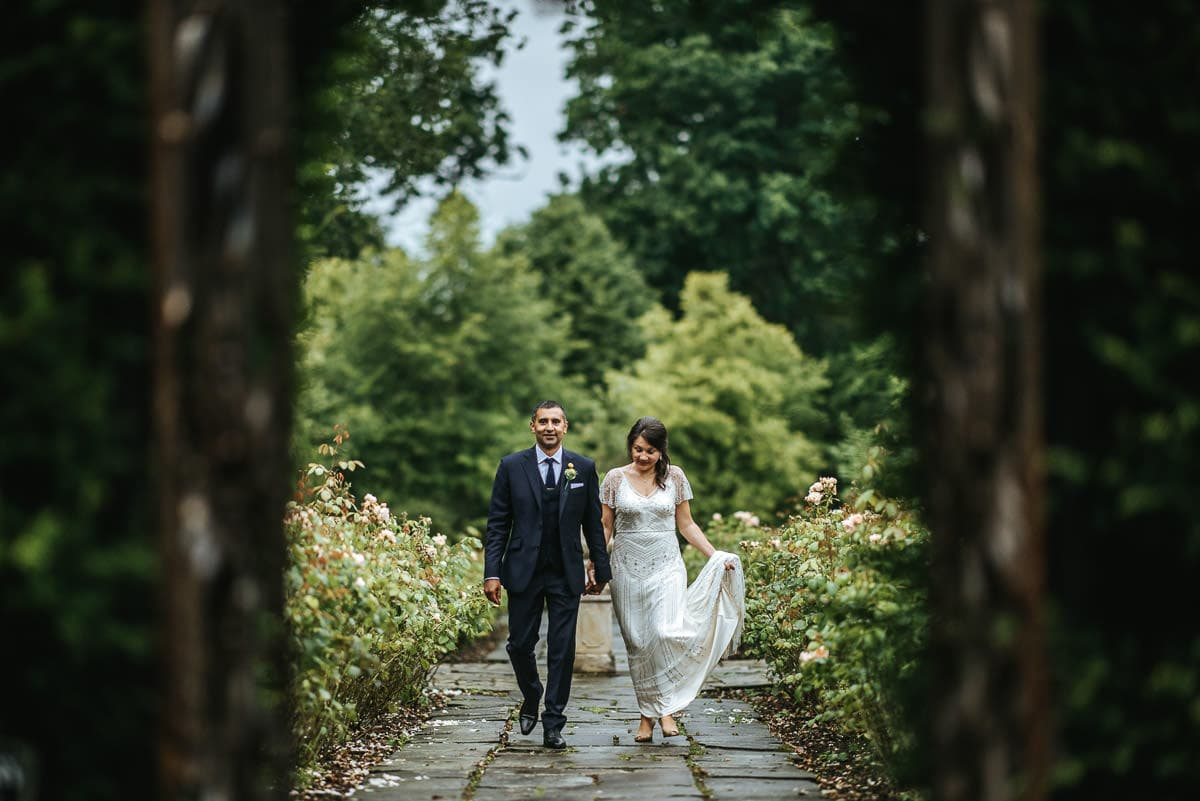 tipi wedding berkshire bride and groom walking