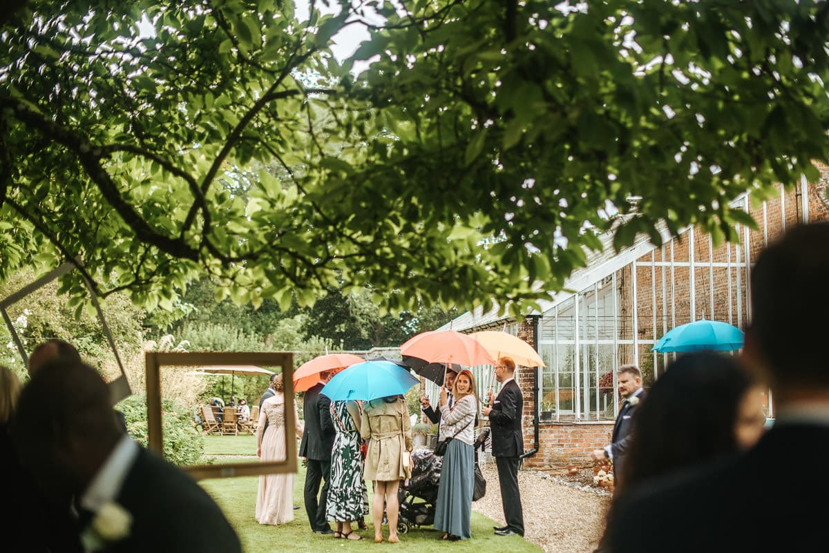 tipi wedding berkshire guests in the rain