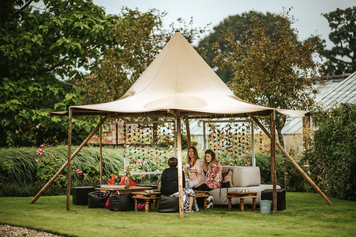 tipi wedding berkshire guest in the palapa