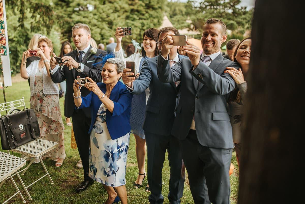 tipi wedding berkshire guest taking photos