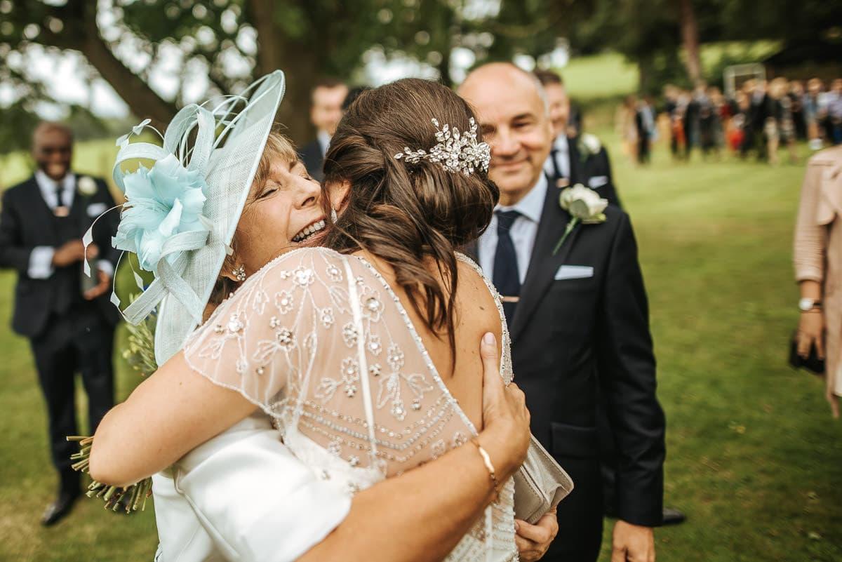 tipi wedding berkshire mum hugging the bride
