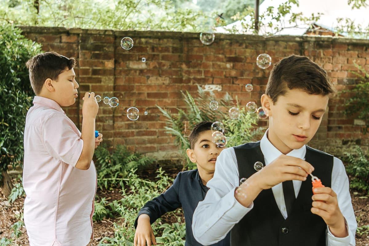 tipi wedding berkshire boys blowing bubbles
