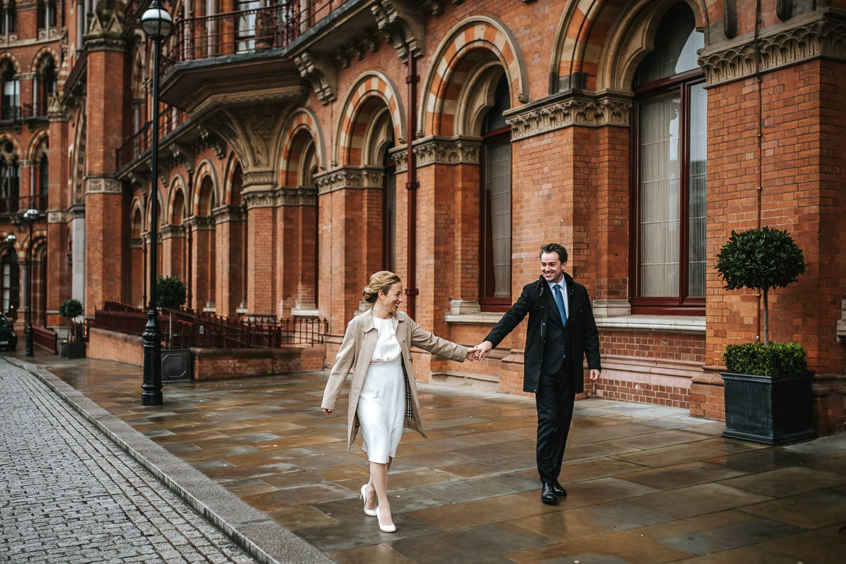 london engagement photography kings cross couple holding hands