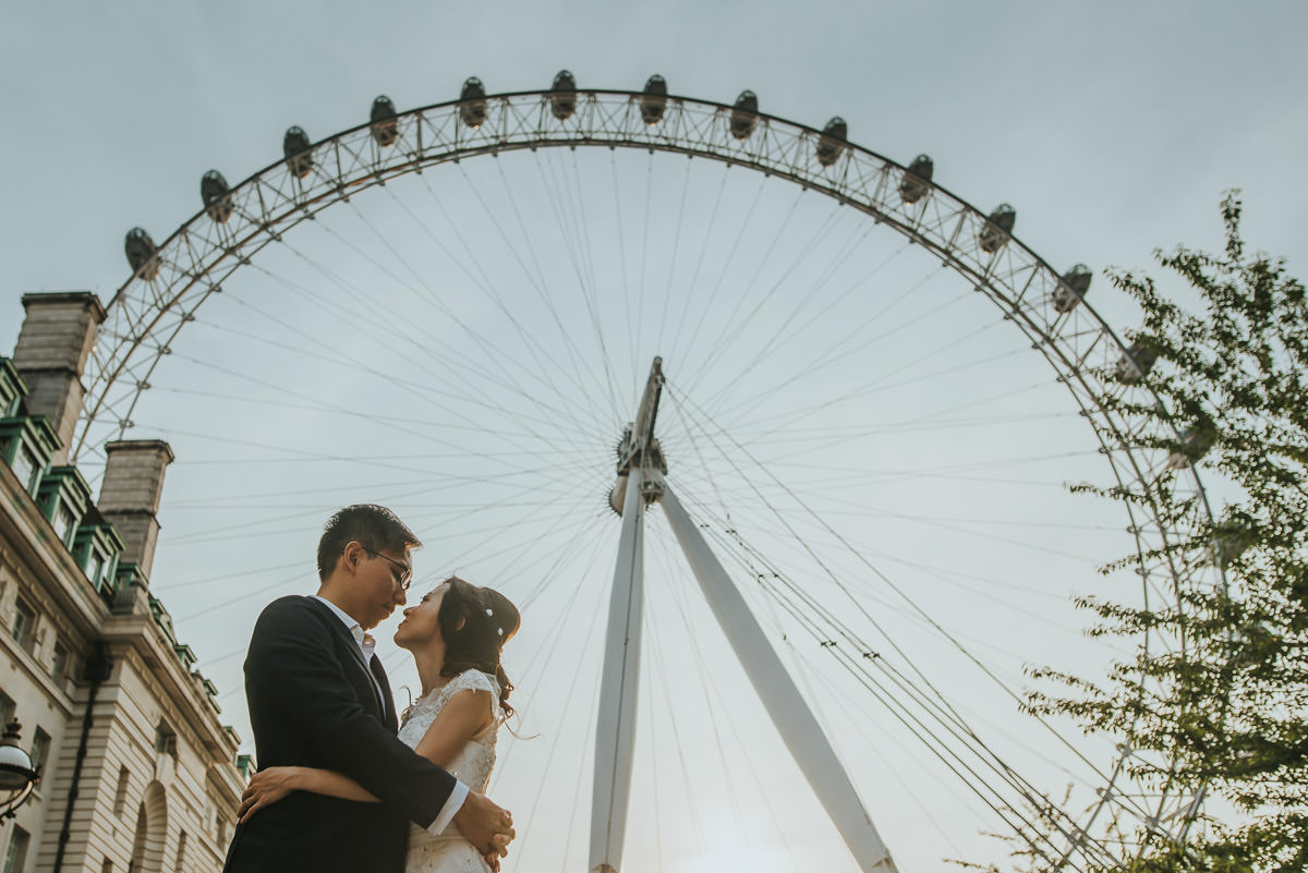 couple embracing by the london eye