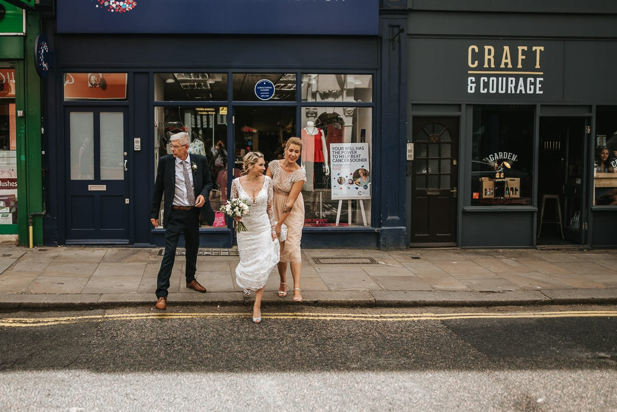islington town hall wedding crossing the road