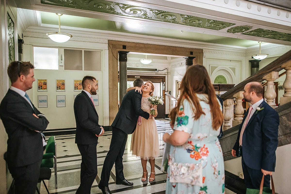 islington town hall wedding guests inside the venue
