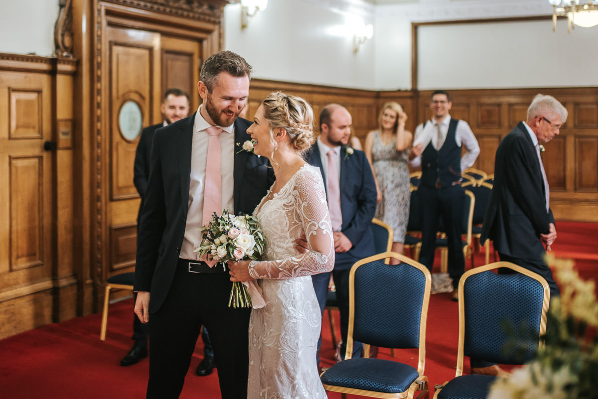 islington town hall wedding bride and groom smiling