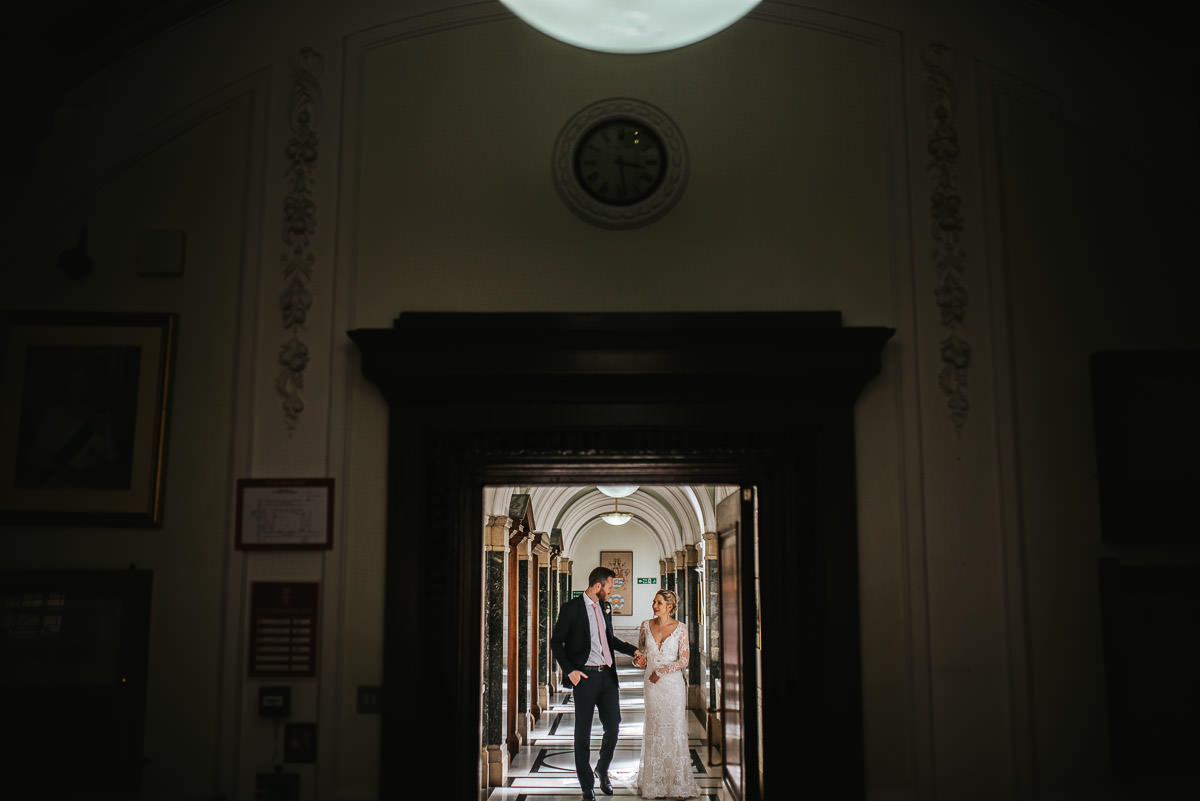 islington town hall wedding couple walking