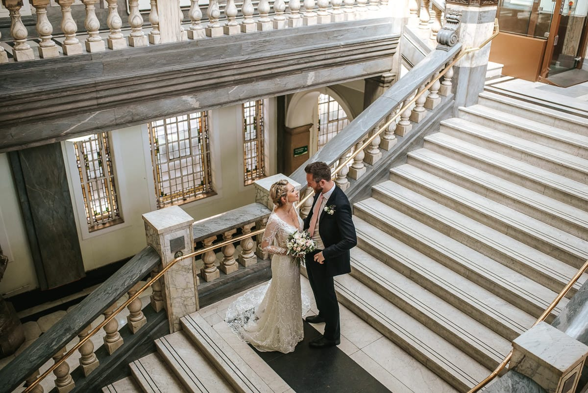 islington town hall wedding couple standing on the steps