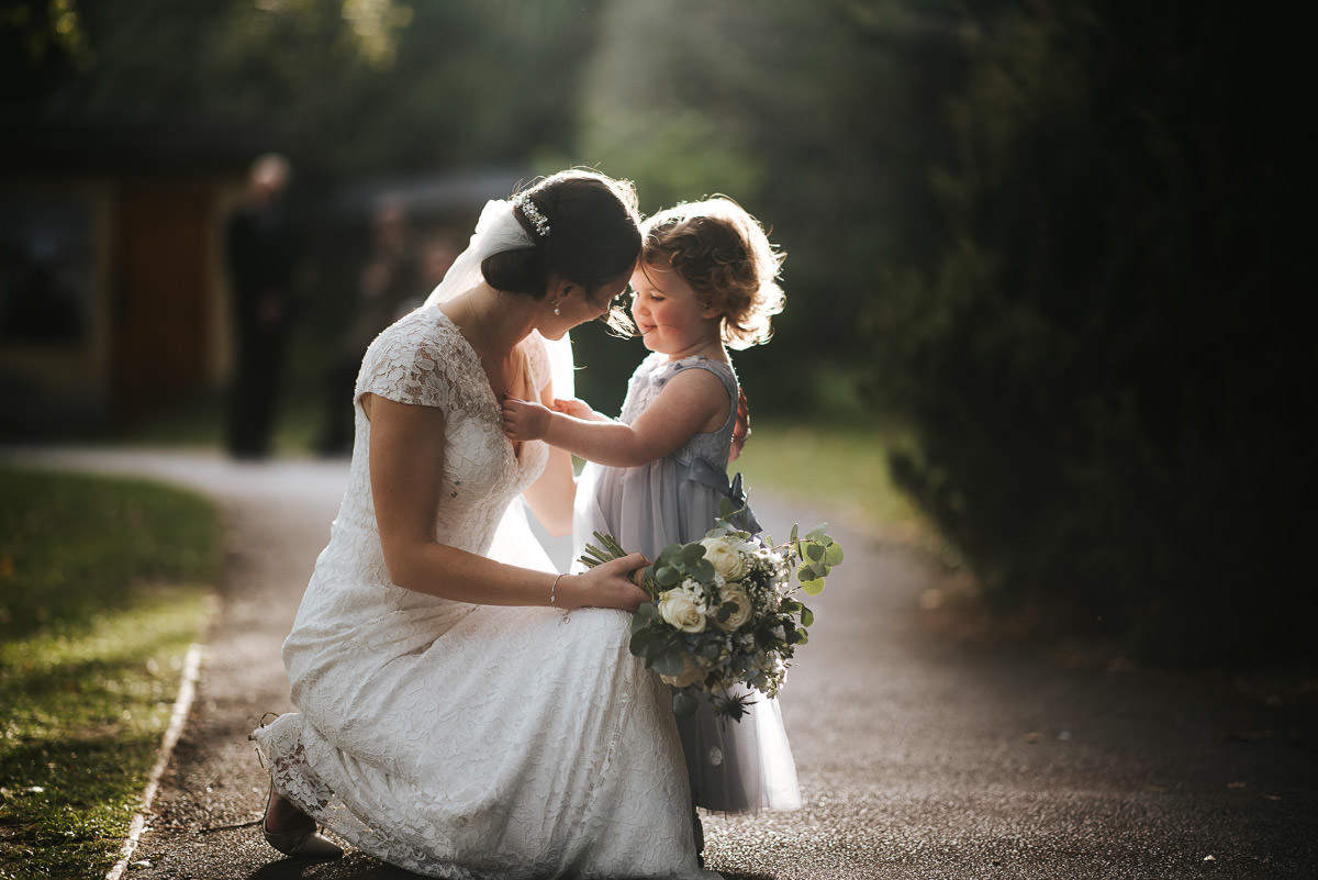 london wetland centre wedding bride hugging flower girl