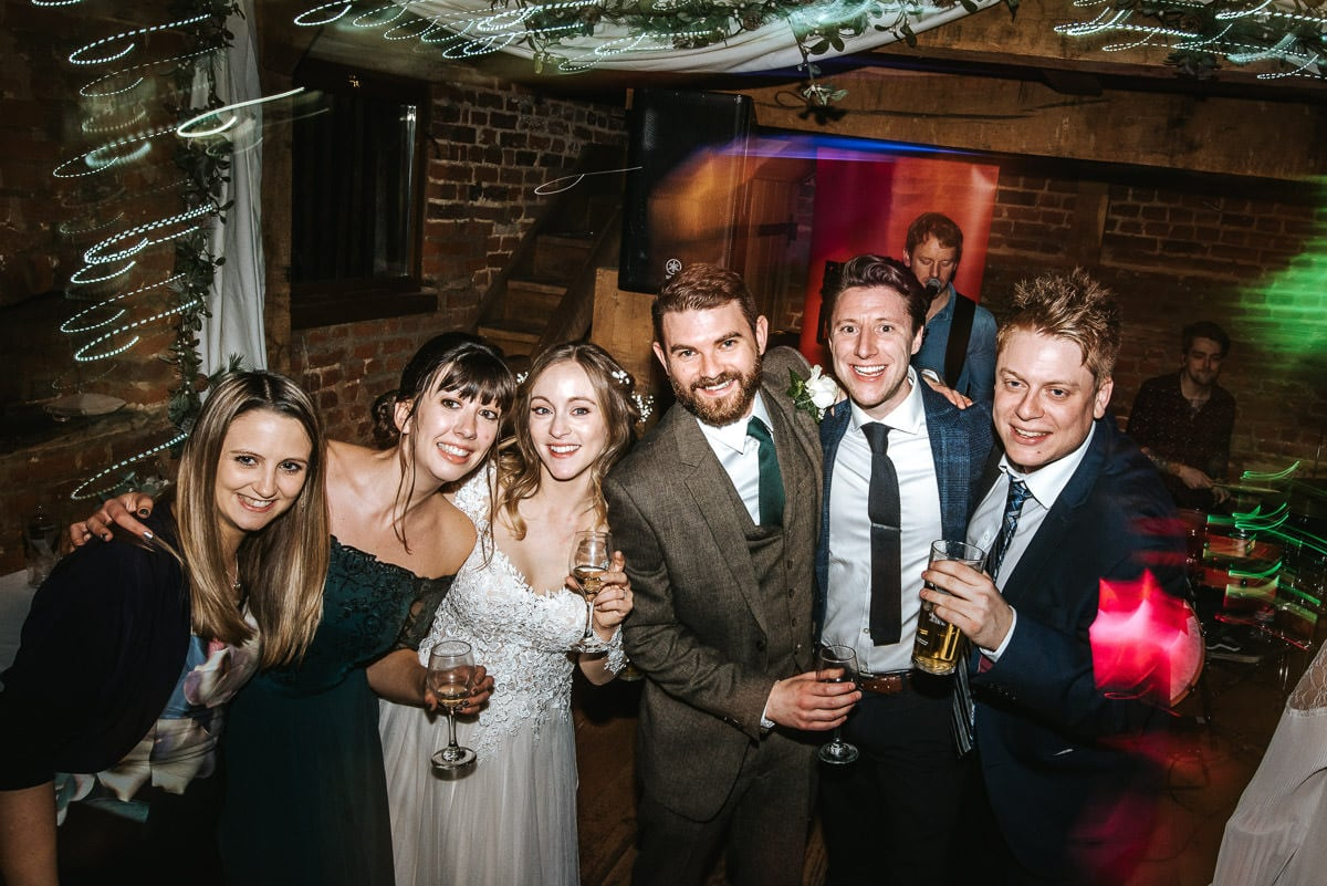 tewin bury farm wedding guests dancing bride and groom with friends