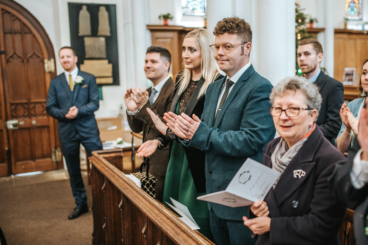 hertfordshire wedding photos ceremony guests clapping