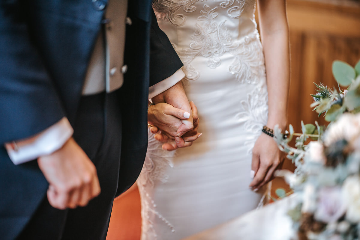 gosfield hall wedding bride and groom holding hands