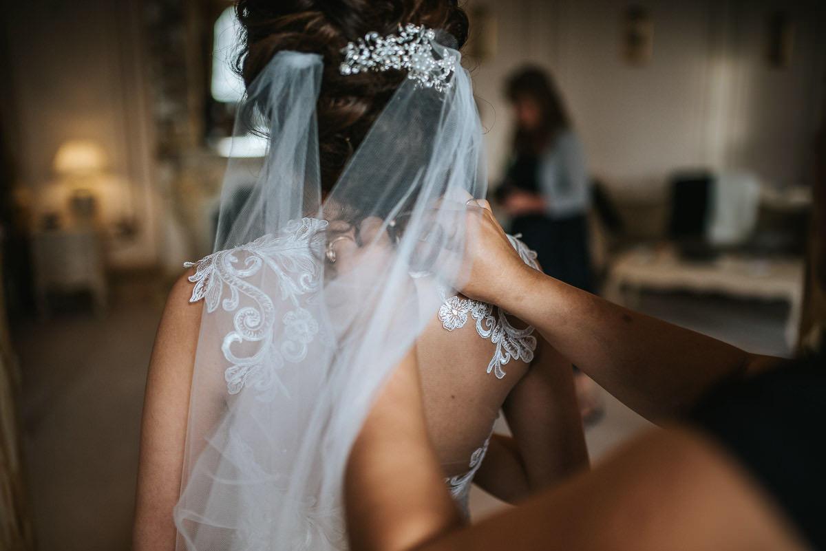 gosfield hall wedding getting ready dress on