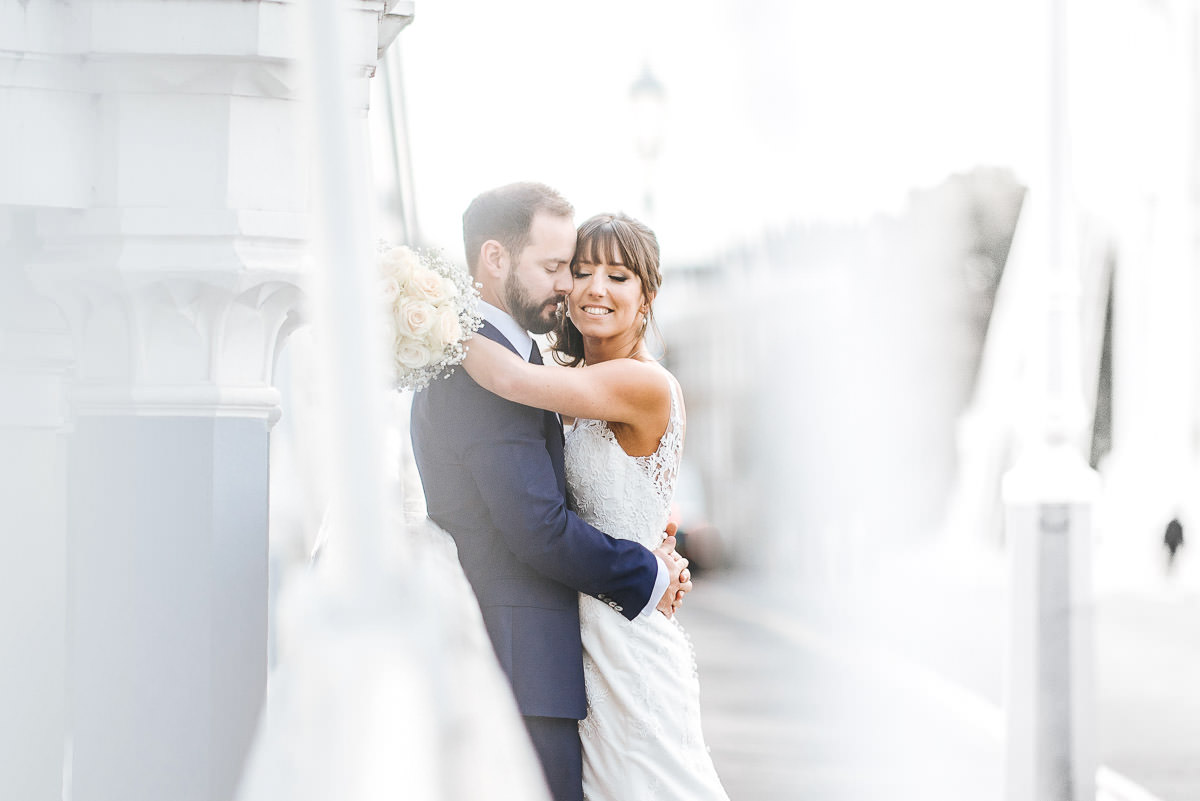 chelsea old town hall wedding couple photo on albert bridge