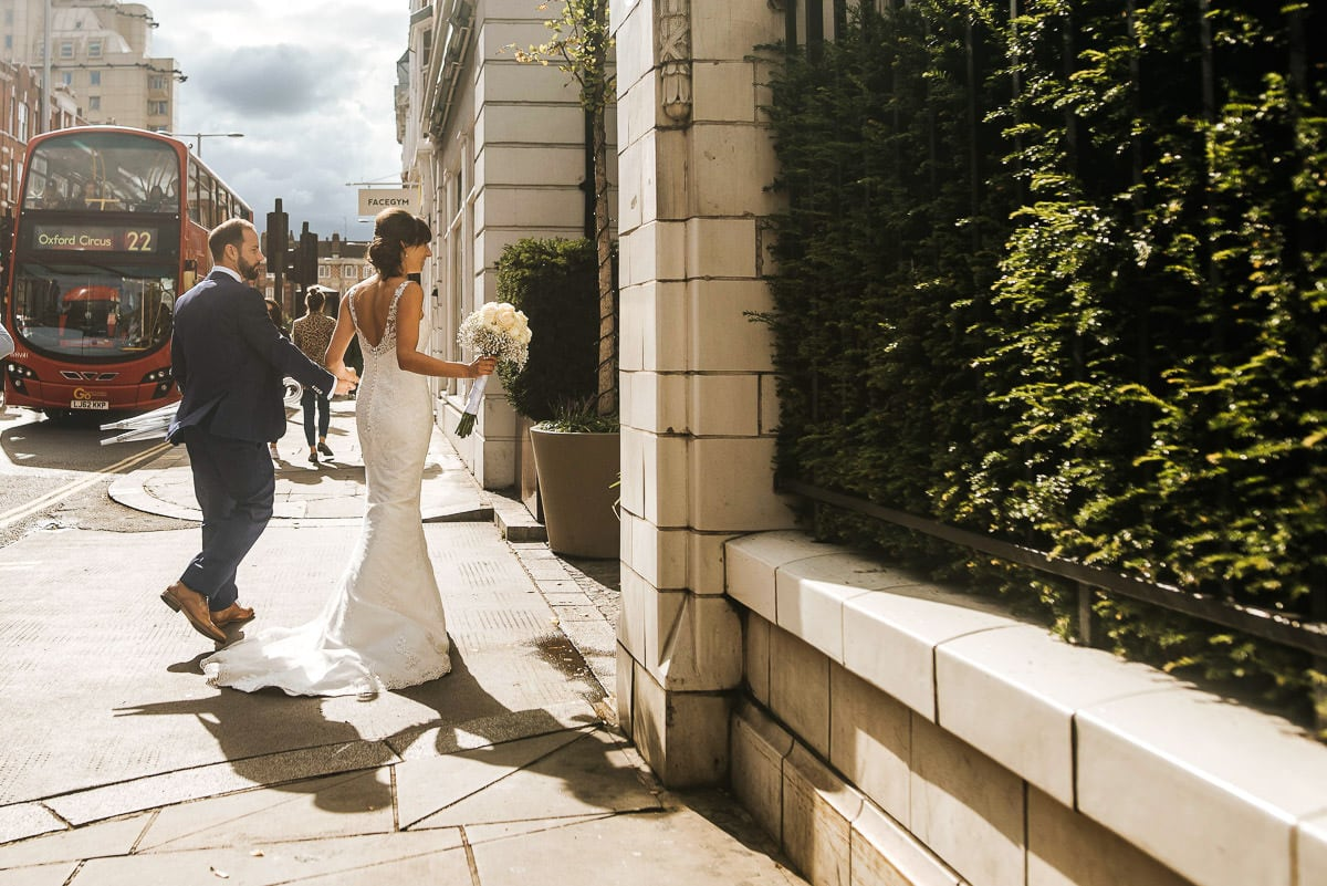 chelsea old town hall wedding bluebird reception bride and grrom walking in