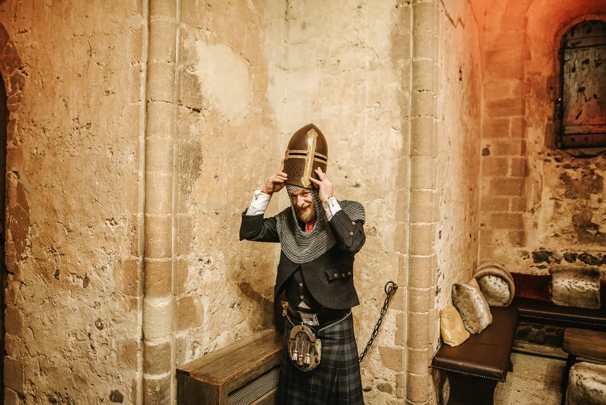 hedingham castle wedding groom dressing as a knight