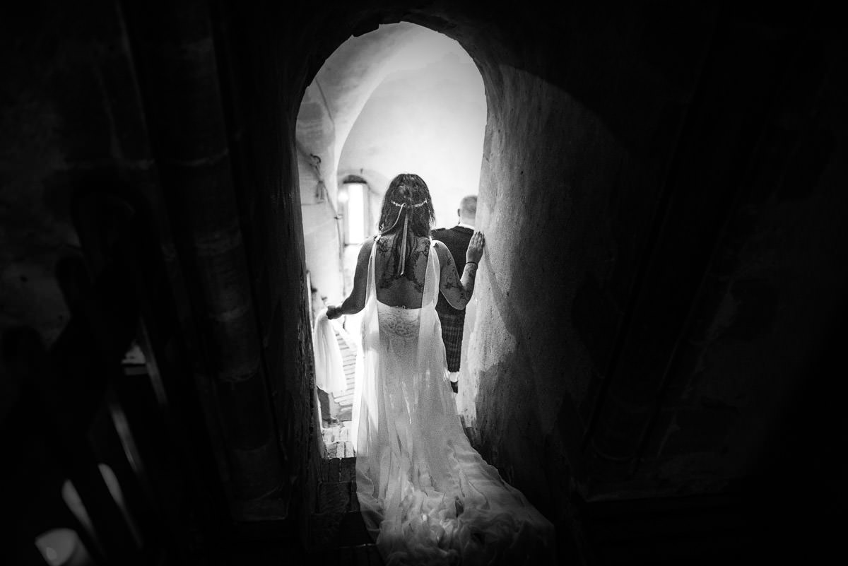 hedingham castle wedding bride walking down the steps