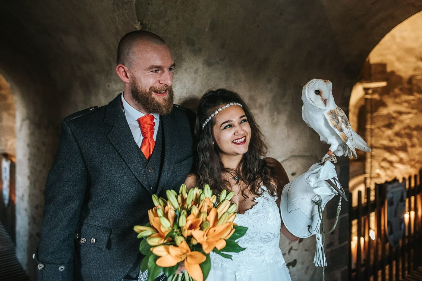 hedingham castle wedding bride and groom posing with an owl