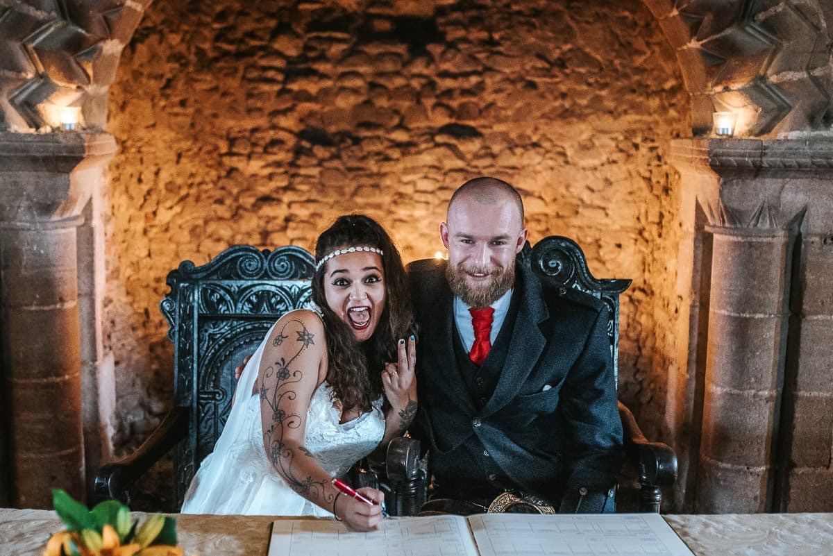 hedingham castle wedding signing the register
