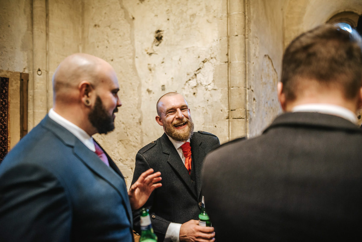 hedingham castle wedding groom laughing