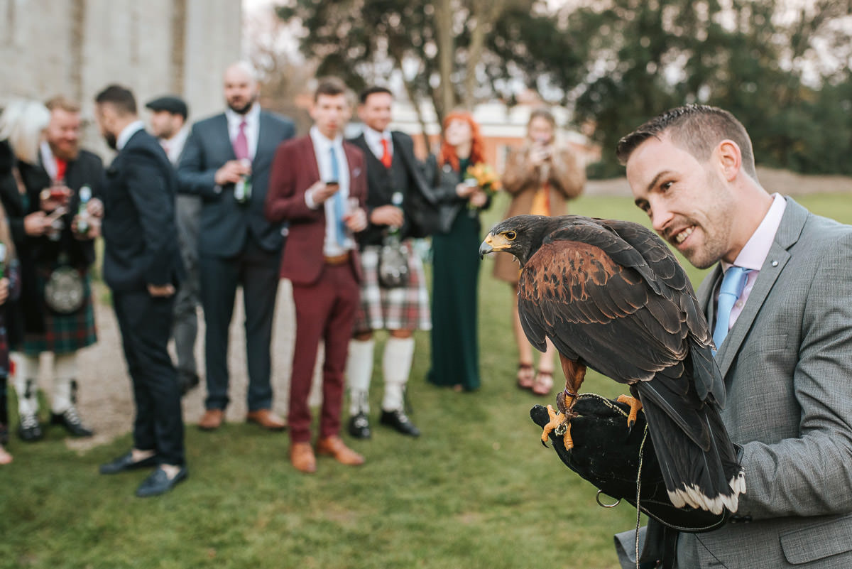 hedingham castle wedding guest holding a falcon