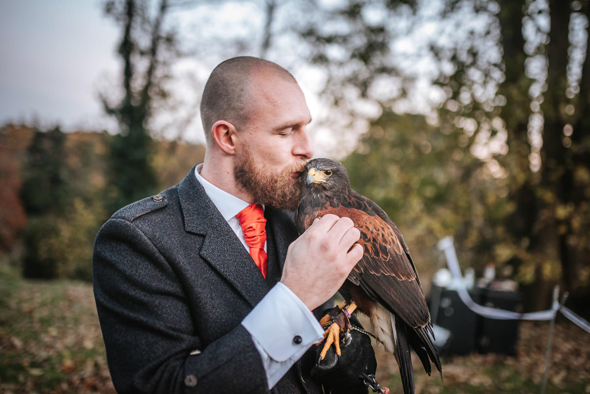 hedingham castle wedding groom with falcon